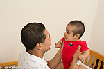 3 month old baby boy held by father interaction happy face to face