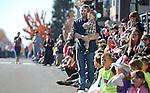 James McKelvey and his son Cayden, of Carson City, watch a veterans float pass by in the 75th annual Nevada Day parade in Carson City, Nev., on Saturday, Oct. 26, 2013.<br /> Photo by Cathleen Allison