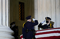 A Supreme Court Honor Guard moves the flag-draped casket of Justice Ruth Bader Ginsburg back into the court as Ginsburg lies in repose under the Portico at the top of the front steps of the U.S. Supreme Court building on Thursday, Sept. 24 2020, in Washington. Ginsburg, 87, died of cancer on Sept. 18.<br /> Credit: Andrew Harnik / Pool via CNP /MediaPunch<br /> CAP/MPI/RS<br /> ©RS/MPI/Capital Pictures
