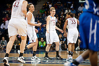 NORFOLK, VA--Toni Kokenis is congratulated by her teammates during competition against Hampton University at the Ted Constant Convocation Center at Old Dominion University in Norfolk, VA in the first round of the 2012 NCAA Championships. The Cardinal advanced with a 73-51 win to play West Virginia on Monday, March 19.
