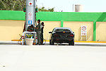 Car pulls in to gas station. Attendant prepares to fill gas.<br /> (1)
