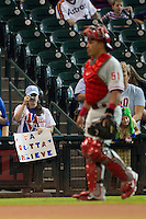 "Philadelphia Phillies fan with a ""Ya Gotta Believe"" sign before the Major League baseball game against the Houston Astros on September 16th, 2012 at Minute Maid Park in Houston, Texas. The Phillies are battling for a playoff spot, but the Astros defeated them 7-6. (Andrew Woolley/Four Seam Images)."