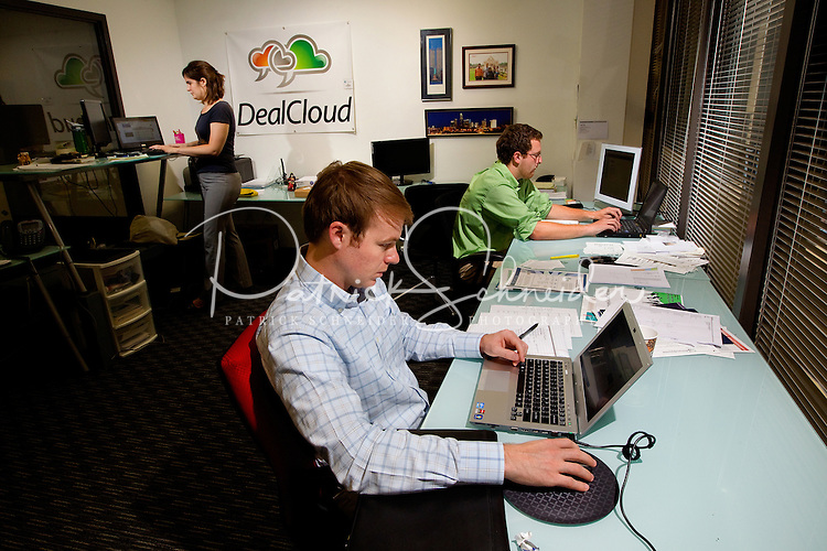 Photography of Packard Place business incubator.  Located in the heart of uptown Charlotte, NC, Packard Place is a hub for entrepreneurship and innovation, helping to grow business startups in the community. Photo shows Deal Cloud Nation, one of the companies located inside of Packard Place.