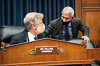 Anthony Fauci, director of the National Institute of Allergy and Infectious Diseases, speaks to United States Representative Frank Pallone (Democrat of New Jersey) and chairman of the US House Energy and Commerce Committee, during a break from a House Energy and Commerce Committee hearing in Washington, D.C., U.S., on Tuesday, June 23, 2020. Trump administration health officials will tell lawmakers that their agencies are preparing for a flu season that will be complicated by the coronavirus pandemic. <br /> Credit: Sarah Silbiger / Pool via CNP/AdMedia