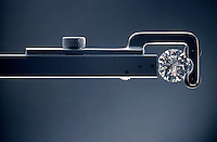 A cut and diamond held in an inspection tool.