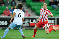 MELBOURNE, AUSTRALIA - FEBRUARY 12: Hirofumi Moriyasu of Sydney FC and Rutger Worm of the Heart compete for the ball in the round 27 A-League match between the Melbourne Heart and Sydney FC at AAMI Park on February 12, 2011 in Melbourne, Australia. (Photo Sydney Low / AsteriskImages.com)