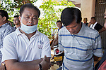 19 October 2013, Pakse, Laos:  Phoseng Vorarat (left) and Tharong Kom Mamouang, brothers of missing Australian woman Phoumalaysy Rhodes,  at the Chinese temple being used as a makeshift morgue in downtown Pakse, Laos following a crash of a Lao Airlines plane into the Sedon river. Mrs Rhodes , husband Gavin and their two children perished after the aircraft crashed into the Mekong River tributary on approach to Pakse airport from Vientiane in severe weather killing all 44 passengers and 5 crew on board. Only the youngest of the family , Manfred has been recovered and identified. Rescue workers are still dragging the fast flowing river for further remains and the main body of the plane.  Picture by Graham Crouch