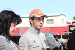 Sergio Perez (6) driver of the Vodafone McLaren Mercedes does an interview before the Formula 1 United States Grand Prix practice session at the Circuit of the Americas race track in Austin,Texas.