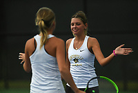 Bentonville's Emily Ferm and Maddie Bynoe score a point, Monday, October 11, 2021 during the 6A state girls and boys tennis tournament at Memorial Park in Bentonville. Check out nwaonline.com/211012Daily/ for today's photo gallery. <br /> (NWA Democrat-Gazette/Charlie Kaijo)