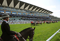 The Royal Procession passes the Grandstand on Ladies Day, the third day of Royal Ascot.