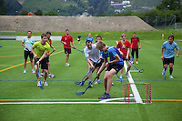 Switzerland. Canton Ticino. Tenero. Centro Sportivo Nazionale della Gioventù - Tenero (CST). Nationales Jugendsportzentrum Tenero. A group of athletes from Swiis Ski teams (skiing and cross-country skiing) are training playing outdoor floorball. 31.05.11 © 2011 Didier Ruef