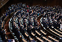 Shinzo Abe and his cabinet members attend Lower House's plenary session at the National Diet