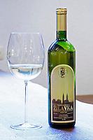 Bottle of Medugorska Zilavka white wine 1999. With a glass of wine. Podrum Vinoteka Sivric winery, Citluk, near Mostar. Federation Bosne i Hercegovine. Bosnia Herzegovina, Europe.