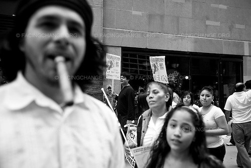 Chicago, Illinois.<br /> USA <br /> May 2010 <br /> <br /> An annual Workers Day march in Chicago turned into an anti-Arizona event as participants railed against that state's new immigration law directing police to check suspected illegal immigrants for proof of legal residency. Police estimated 8,000 protesters about four times the number who attended last year's May Day.