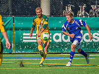 28 September 2013: University of Vermont Catamount Defenseman Nile Walwyn, a Sophomore from Mississauga, Ontario, in action against the Hartwick College Hawks at Virtue Field in Burlington, Vermont. The Catamounts shut out the visiting Hawks 1-0. Mandatory Credit: Ed Wolfstein Photo *** RAW (NEF) Image File Available ***