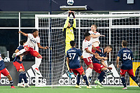 FOXBOROUGH, MA - JUNE 26: Earl Edwards Jr. #90 of the New England Revolution punches the ball away off a corner kick during a game between North Texas SC and New England Revolution II at Gillette Stadium on June 26, 2021 in Foxborough, Massachusetts.
