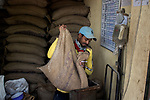 An emergency worker at work in a government controlled ration shop in Kolkata, West Bengal, India. Arindam Mukherjee.