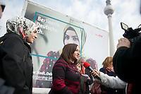 """Praesentation einer Einbuergerungskampagne des Berliner Senats unter dem Motto """"Deine Stadt. Dein Land. Dein Pass."""" der Berliner Senatorin fuer Arbeit, Integration und Frauen, Dilek Kolat, am Montag den 8. April 2013. Die Senatorin spricht sich dagegen aus, die urspruengliche Staatsangehoerigkeit abzulegen um einen Deutschen Pass beantragen zu koennen.<br />Im Bild vlnr.: Die Deutsch-Tuerkin Muna Lekesiz, Model eines der Kampagnenplakate mit der Senatorin Dilek Kolat.<br />8.4.2013, Berlin<br />Copyright: Christian-Ditsch.de<br />[Inhaltsveraendernde Manipulation des Fotos nur nach ausdruecklicher Genehmigung des Fotografen. Vereinbarungen ueber Abtretung von Persoenlichkeitsrechten/Model Release der abgebildeten Person/Personen liegen nicht vor. NO MODEL RELEASE! Don't publish without copyright Christian-Ditsch.de, Veroeffentlichung nur mit Fotografennennung, sowie gegen Honorar, MwSt. und Beleg. Konto:, I N G - D i B a, IBAN DE58500105175400192269, BIC INGDDEFFXXX, Kontakt: post@christian-ditsch.de<br />Urhebervermerk wird gemaess Paragraph 13 UHG verlangt.]"""