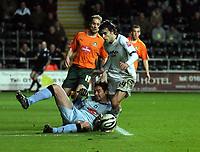 Pictured: Jordi Gomez of Swansea (R) is toppled over by Romain Larrieu, goalkeeper for Plymouth Argyle (on the ground) which earned the former's team a penalty scored by Jason Scotland (not pictured).<br /> Picture by D Legakis / Athena Picture Agency, Swansea, 07815441513