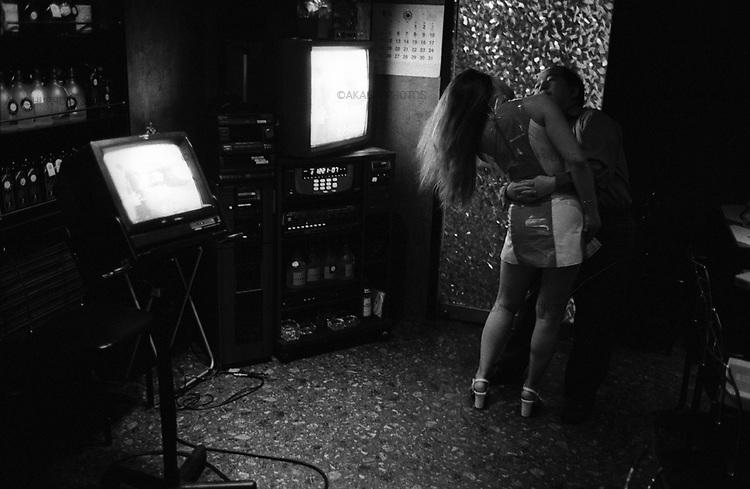 A Chinese girl dances with her customer in a Karaoke bar in Tokyo at 0:22am.<br /> <br /> Une Chinoise danse avec son client dans un bar de karaoké à Tokyo à 00h22.