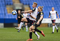 Bolton Wanderers' Eoin Doyle competing with Oldham Athletic's Carl Piergianni (right) <br /> <br /> Photographer Andrew Kearns/CameraSport<br /> <br /> The EFL Sky Bet League Two - Bolton Wanderers v Oldham Athletic - Saturday 17th October 2020 - University of Bolton Stadium - Bolton<br /> <br /> World Copyright © 2020 CameraSport. All rights reserved. 43 Linden Ave. Countesthorpe. Leicester. England. LE8 5PG - Tel: +44 (0) 116 277 4147 - admin@camerasport.com - www.camerasport.com