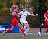 Boston College midfielder/defender Alicia Blose (13) passes the ball as Marist College forward/midfielder Marjana Maksuti (12) closes. Boston College defeated Marist College, 6-1, in NCAA tournament play at Newton Campus Field, November 13, 2011.