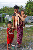 Bali, Indonesia.  Balinese Mother and Children.