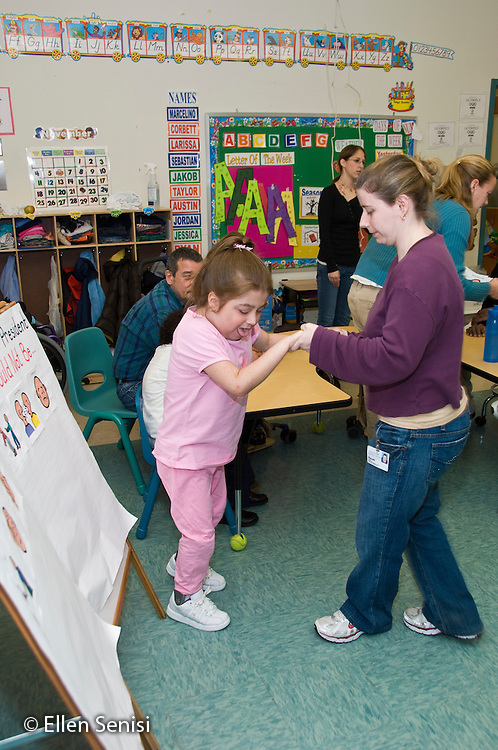 MR / Albany, NY.Langan School at Center for Disability Services .Ungraded private school which serves individuals with multiple disabilities.Aide helps girl walking in classroom. Girl: 11, cerebral palsy, non verbal with expressive and receptive language delays..MR: Gor3, Gol5.© Ellen B. Senisi