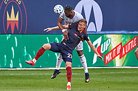 CHICAGO, UNITED STATES - AUGUST 25: Kendall Waston #2 of FC Cincinnati battles with Robert Beric #27 of Chicago Fire for the ball during a game between FC Cincinnati and Chicago Fire at Soldier Field on August 25, 2020 in Chicago, Illinois.