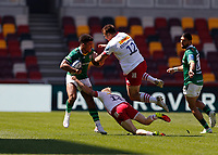24th April 2021; Brentford Community Stadium, London, England; Gallagher Premiership Rugby, London Irish versus Harlequins; Ben Loader of London Irish tackled by Tyrone Green and Andre Esterhuizen of Harlequins