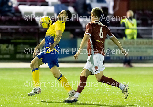 Kelty Hearts v St Johnstone…07.10.20   New Central Park  Betfred Cup<br />Craig Conway is closed down by Thomas Reilly<br />Picture by Graeme Hart.<br />Copyright Perthshire Picture Agency<br />Tel: 01738 623350  Mobile: 07990 594431