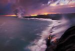 Steam plumes erupt when molten lava hits the surf.
