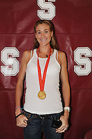 Stanford, CA - SEPTEMBER 11:  Former Stanford Cardinal volleyball great Kerri Walsh poses for a photo with her 2008 Beijing Olympics gold medal during Stanford's 25-17, 25-16, 26-24 win against the New Mexico State Aggies in the Stanford Invitational on September 11, 2008 at Maples Pavilion in Stanford, California.