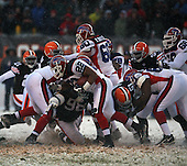 December 16th, 2007: Buffalo Bills running back Fred Jackson (22) is stopped for a minimal gain by Cleveland Browns linebacker Chaun Thompson (51) and defensive lineman Robaire Smith (98) at Cleveland Browns Stadium in Cleveland, Ohio.  The Browns shutout the Bills 8-0 to inch closer to a playoff sport.  Photo copyright Mike Janes Photography 2007.