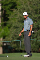 PONTE VEDRA BEACH, FL - MAY 5: Tiger Woods jokes with his playing partner (Nick Watney) on the 4th green during their practice round on Tuesday, May 5, 2009 for the Players Championship, beginning on Thursday, at TPC Sawgrass in Ponte Vedra Beach, Florida.