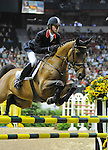 17 April 2009: Ben Maher (GBR) and Robin Hood W at the Rolex World Cup Jumping Final II.