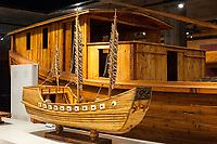 Suzhou, Jiangsu, China.  Full-size and Miniature Replicas of Canal Boat used to Transport Imperial Bricks to Beijing.  Suzhou Museum of Imperial Kiln Brick.