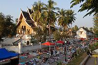 LAOS  Luang Prabang, street market and buddhist temple Sala Pha Bang at kings palace / Luang Prabang, Strassenmarkt und buddhistischer Tempel Sala Pha Bang am Koenigspalast