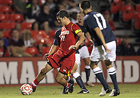 COLLEGE PARK, MD. - AUGUST 20, 2012:  John Stertzer (27) of  the University of Maryland brings the ball around against Julian Cardona (17) of Penn State during an NCAA match at Ludwig Field, in College Park, Maryland on August 20. The game ended in a 2-2 tie.