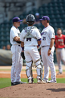 Winston-Salem Dash pitching coach Matt Zaleski (25) had a meeting on the mound with starting pitcher Jonathan Stiever (17) and catcher Carlos Perez (14) during the game against the Carolina Mudcats at BB&T Ballpark on August 4, 2019 in Winston-Salem, North Carolina. The Dash defeated the Mudcats 7-5. (Brian Westerholt/Four Seam Images)