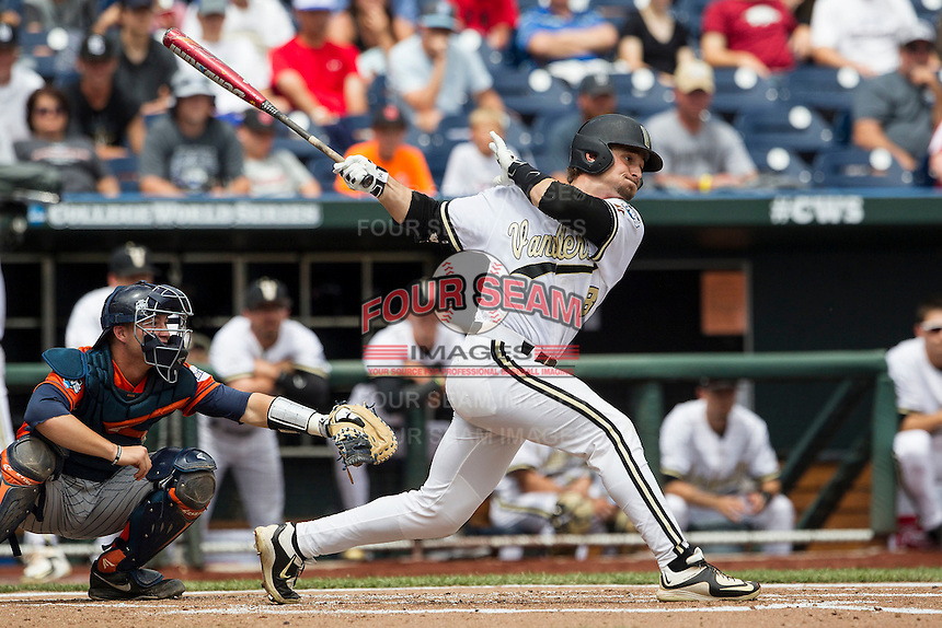 Vanderbilt Commodores outfielder Rhett Wiseman (8) follows through on his swing during the NCAA College baseball World Series against the Cal State Fullerton Titans on June 15, 2015 at TD Ameritrade Park in Omaha, Nebraska. Vanderbilt beat Cal State Fullerton 4-3. (Andrew Woolley/Four Seam Images)