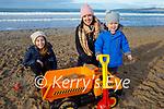 Laura O'Sullivan, Eimear and Max Costello and Bailey the dog enjoying Banna Beach on Friday.