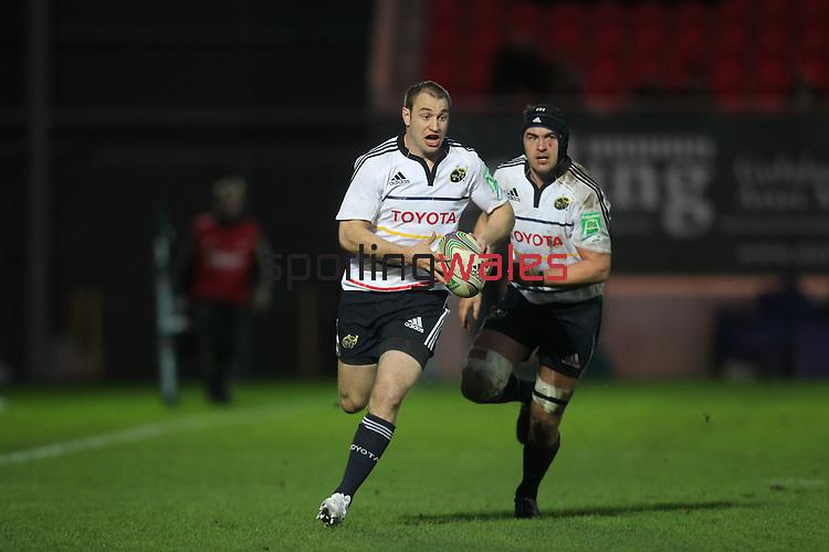 Johne Murphy and Niall Ronan..Heineken Cup.Scarlets v Munster.Parc y Scarlets.10.12.11.©Steve Pope