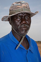 Millet Cultivation.  Senior Family Member of the Family Owning the Land at this location.  He is a member of the Serer ethnic group.  Kaolack, Senegal. DOZENS MORE OF IMAGES RELATED TO MILLET CULTIVATION ARE AVAILABLE.  WHAT DO YOU NEED?