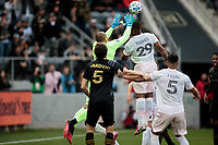 LOS ANGELES, CA - MARCH 01: GK Luis Robles #31 and Roman Torres #29 of Inter Miami CF both leap high for a ball in the box during a game between Inter Miami CF and Los Angeles FC at Banc of California Stadium on March 01, 2020 in Los Angeles, California.