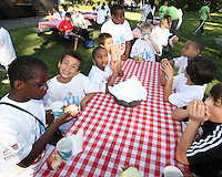 """Kids and Apples during a  D.C United clinic in support of first lady Michelle Obama's """"Let's Move"""" initiative on the White House lawn, in Washington D.C. on October 7 2010."""