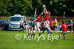 St Pats Liam Poff rises highest to gain possession against Churchill in the County Senior football league on Sunday.