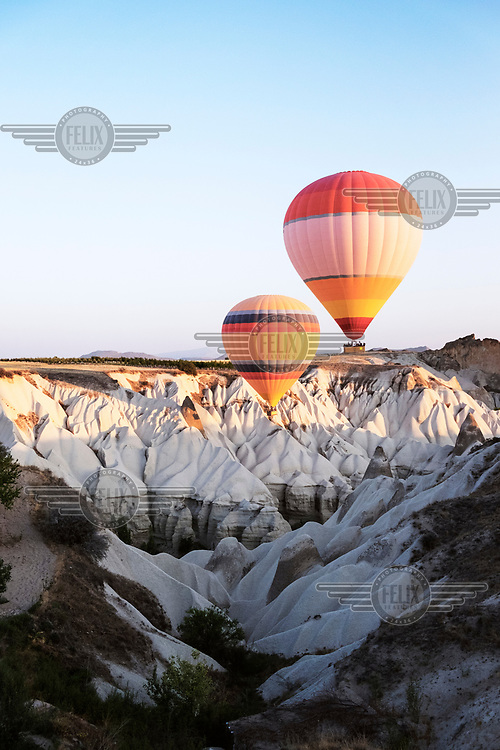 Touristsmake hot air balloon flights over Goreme and its famed rock formations (knowed as hoodoos).