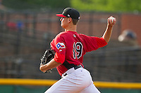 Hickory Crawdads starting pitcher Connor Sadzeck (19) delivers a pitch to the plate against the Kannapolis Intimidators at L.P. Frans Stadium on May 25, 2013 in Hickory, North Carolina.  The Crawdads defeated the Intimidators 14-3.  (Brian Westerholt/Four Seam Images)