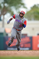 Dominican Republican first baseman Carlos Santana (41) running the bases runs the bases during a Spring Training exhibition game against the Baltimore Orioles on March 7, 2017 at Ed Smith Stadium in Sarasota, Florida.  Baltimore defeated the Dominican Republic 5-4.  (Mike Janes/Four Seam Images)